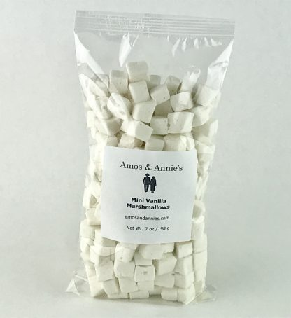 Mini vanilla marshmallows in a clear bag setting on a white background