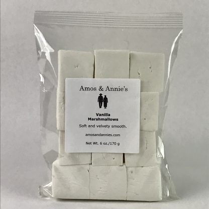 Twelve vanilla marshmallows in a clear bag setting on a white background